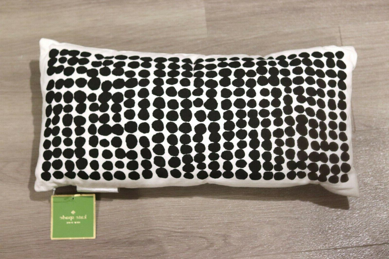 black and white dotted rectangular throw pillow